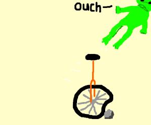 Frog falling off unicycle