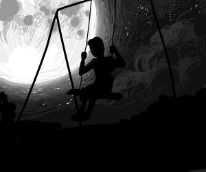 Boy swings alone in the moonlight