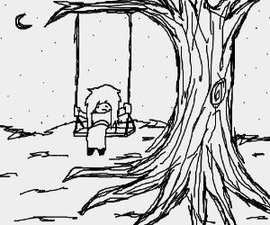 Girl on a swing at night is heartbroken