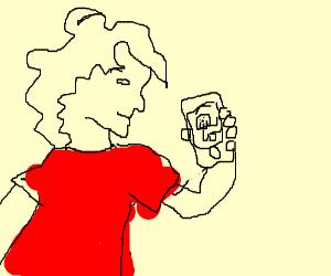 man in red shirt watching a dog vid