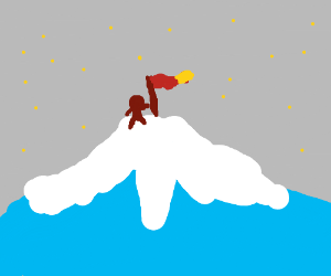 man climbs to the top of a mountain