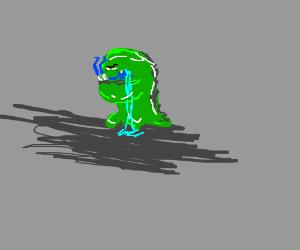 blue man, eaten by green blob, cries