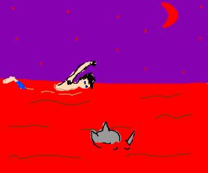 man and rhino swimming in blood