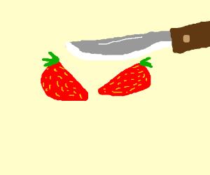 Cutting a strawberry in half