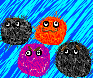 red fuzzball, black fuzzballs and pink fuzzbal