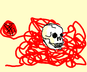 A skull sitting in a tangled pile of yarn
