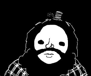 bearded man in flannel wearing tiny hat