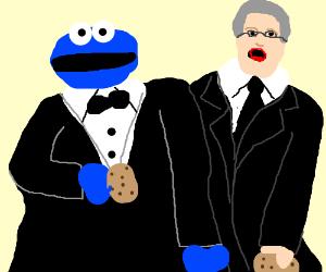 Cookie monster eats cookie w/his puppeteer