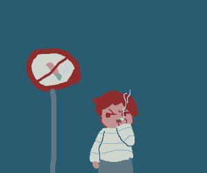 Child smokes beside smoking sign.