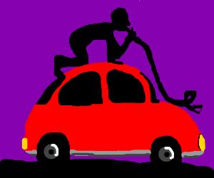 Snake being eaten above car