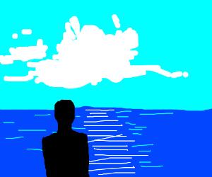 Man looking over the ocean