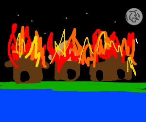 View of night sky and town burning from river