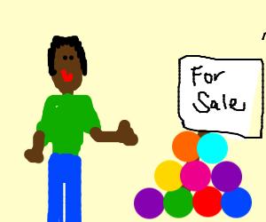 black guy selling colorful balls