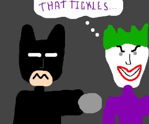batman punches joker