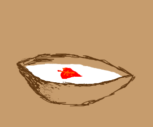A red leaf floating in a bowl of milk.
