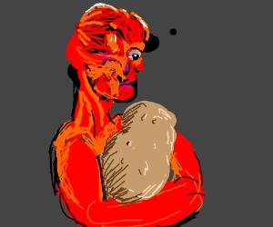 An inside out man cradling a potato.