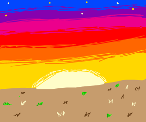 Sunset over plain of dead grass