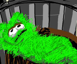Oscar the Grouch slouched on a couch.