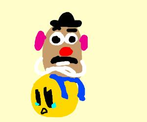 Mister Potatohead sits on emoji