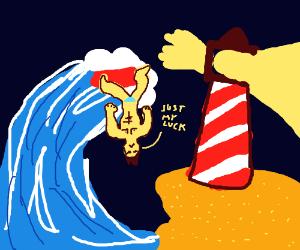 surfer falling off wave, against lighthouse