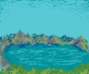 peacefull view of mountains around a lake