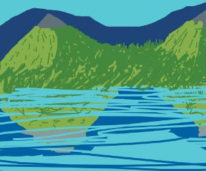 Lake by a mountain