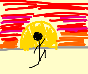 a man walking into the sunset