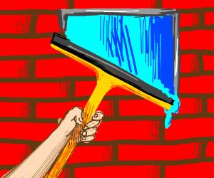 WIndow washer paints a window on a brick wall
