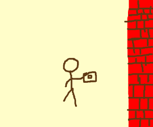 a guy with a camera stands in front of a wall