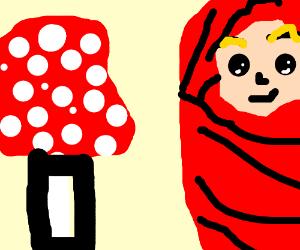 suprised baby sees a mini mushroom house
