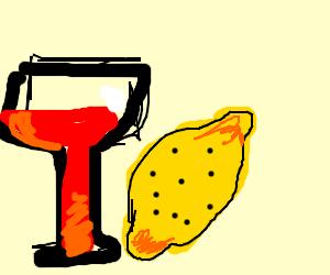 glass of wine next to a lemon