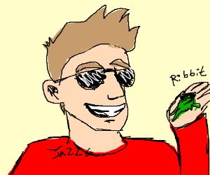Jazza wearing sunglasses holding a frog