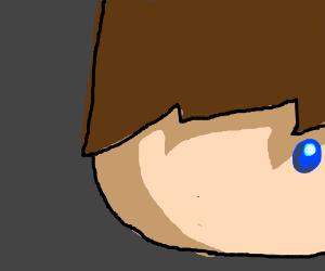 Brunette boy has one blue eye