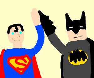 Batman and Superman high five.