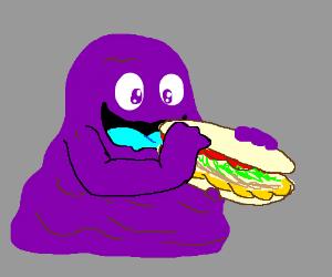 Sludge monster eats a sub sandwich