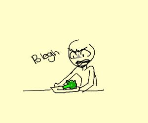 Boy not liking the veggies.