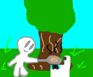 guy cooking pancakes by a tree