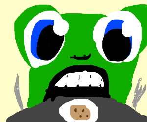 green creature eating