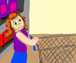 Lady pushing a shopping cart through the store