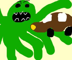giant green alien /octopus eating a car