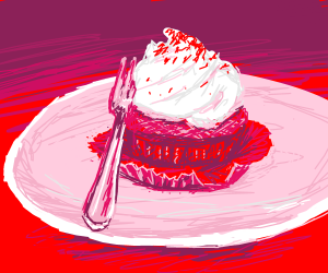A fork and a Cupcake on a plate