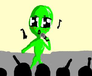 A kawaii alian singing on stage