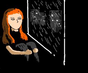 girl looking outside window its raining