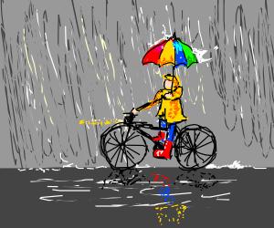 Person riding their bike in the rain
