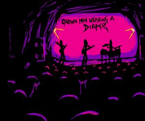 A grown men wearing a diaper at a rock concert