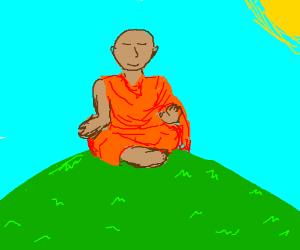Munk meditating ontop of a hill
