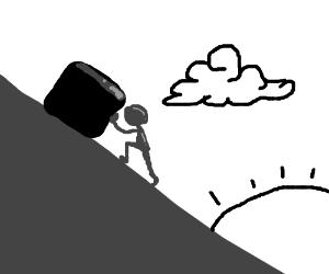 Man pushing box up slanted surface