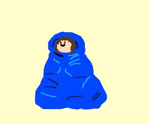 man huddled in a blanket