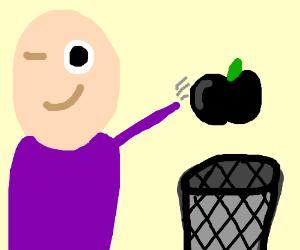 Winking man throwing away a black fruit