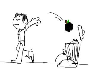 Throwing black apple in the trash
